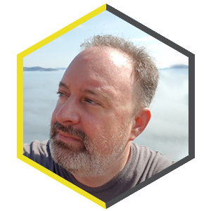 Hexagon shaped profile picture featuring Daniel McGowan