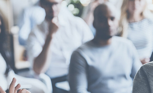 Peter Drucker Global Forum Header showing speaker standing in front of audience
